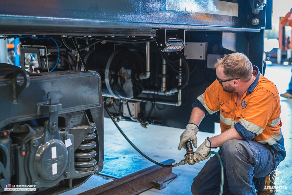 Photographs of lifting and transportation of Speno US7 Rail Maintenance Machine